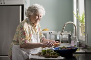Elderly Woman Alone Home Cooking When to Worry