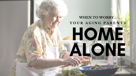 Happy elderly woman alone at home cooking in her kitchen